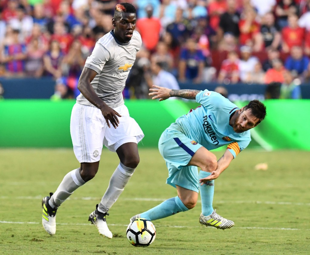 Pogba could well have been playing alongside Messi. (Photo by Nicholas Kamm/AFP/Getty Images)