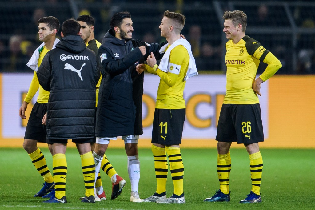 DORTMUND, GERMANY - DECEMBER 15: Nuri Sahin of Bremen with Marco Reus and Lukasz Piszczek after the Bundesliga match between Borussia Dortmund and SV Werder Bremen at the Signal Iduna Park on December 15, 2018 in Dortmund, Germany. (Photo by Jörg Schüler/Getty Images)