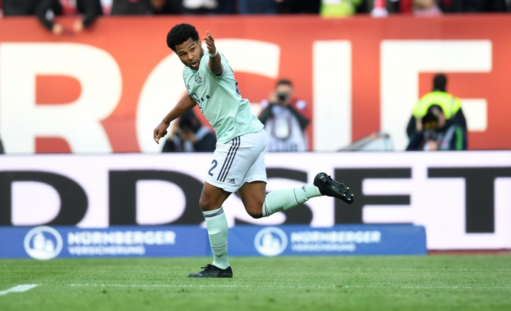 Bayern Munich's German midfielder Serge Gnabry celebrate scoring during the German first division Bundesliga football match Nuremberg v FC Bayern Munich on April 28, 2019 in Nuremberg, southern Germany. (Photo by Christof STACHE / AFP) / RESTRICTIONS: DFL REGULATIONS PROHIBIT ANY USE OF PHOTOGRAPHS AS IMAGE SEQUENCES AND/OR QUASI-VIDEO (Photo credit should read CHRISTOF STACHE/AFP/Getty Images)