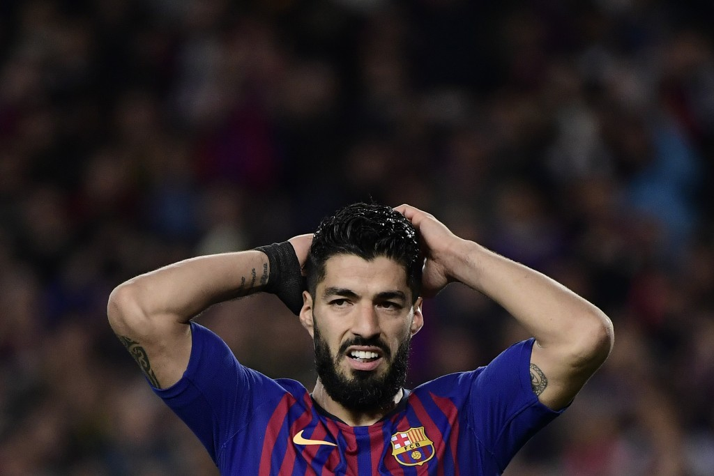 Barcelona's Uruguayan forward Luis Suarez reacts after missing a goal opportunity during the UEFA Champions League semi-final first leg football match between Barcelona and Liverpool at the Camp Nou Stadium in Barcelona on May 1, 2019. (Photo by JAVIER SORIANO / AFP) (Photo credit should read JAVIER SORIANO/AFP/Getty Images)