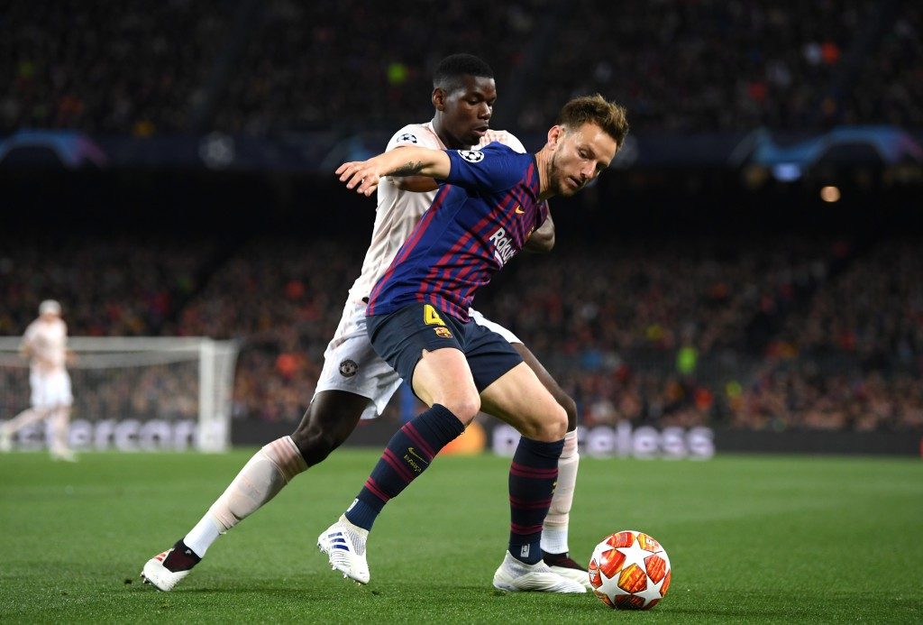 Could Rakitic and Paul Pogba be lining up alongside each other at Manchester United next season? (Photo by Matthias Hangst/Getty Images)