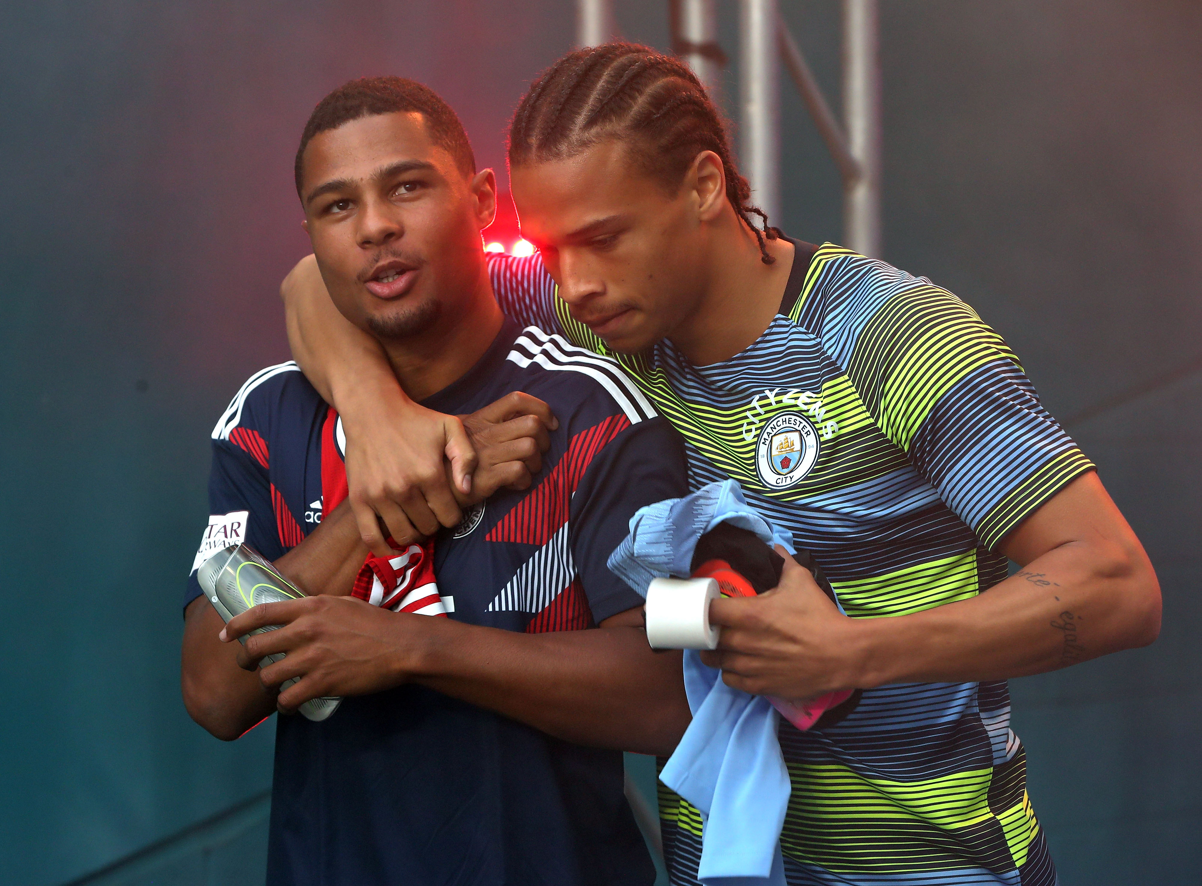 Former Arsenal star Serge Gnarby (L) wants International teammate Leroy Sane (R) to join him at Bayern. (Photo courtesy: AFP/Getty)