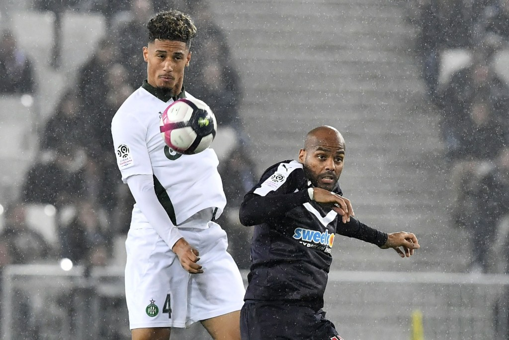Saliba (L) closing in on Arsenal transfer? (Photo by NICOLAS TUCAT/AFP/Getty Images)