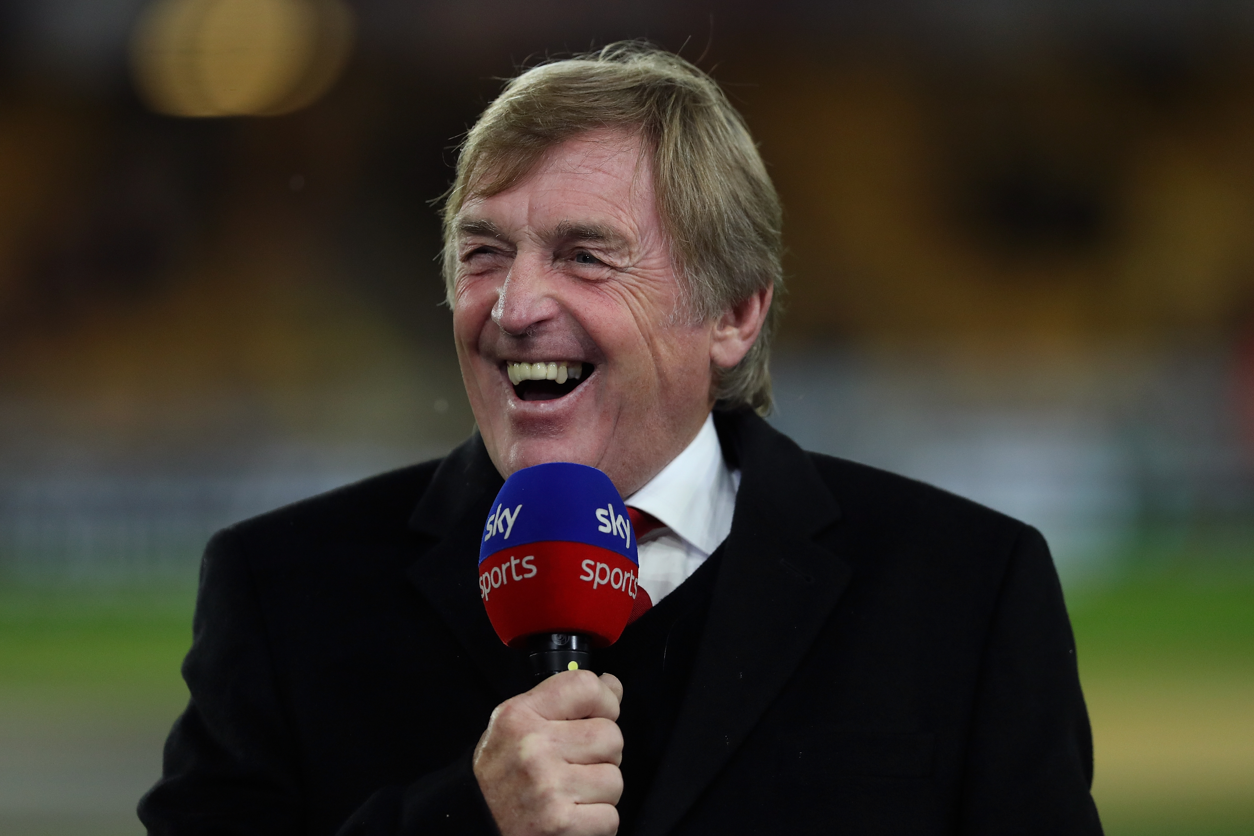 Kenny Dalglish hopes Robertson stays put at Anfield. (Photo courtesy: AFP/Getty)