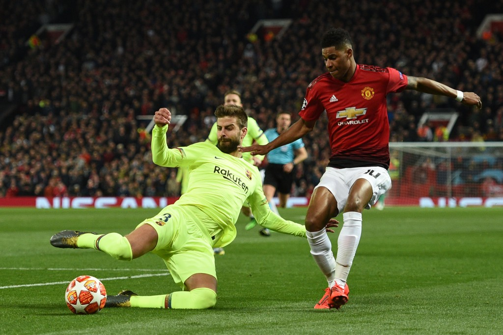 Could Rashford be lining up alongside Gerard Pique soon? (Photo by Oli Scarff/AFP/Getty Images)