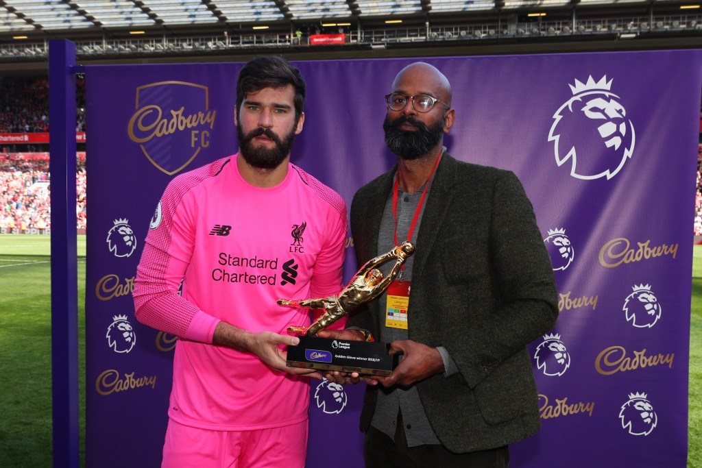 LIVERPOOL, ENGLAND - MAY 12: Alisson of Liverpool poses for a photo with the golden glove award after the Premier League match between Liverpool FC and Wolverhampton Wanderers at Anfield on May 12, 2019 in Liverpool, United Kingdom. (Photo by Catherine Ivill/Getty Images)