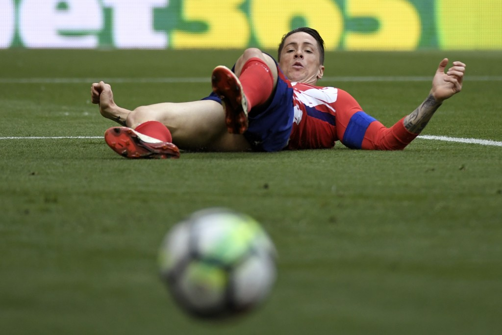 Time to step away from the ball. (Picture Courtesy - AFP/Getty Images)