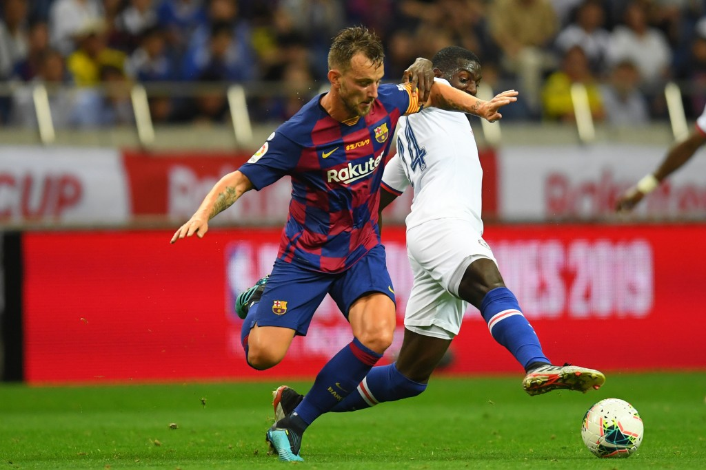 Rakitic going nowhere (Photo by Atsushi Tomura/Getty Images)