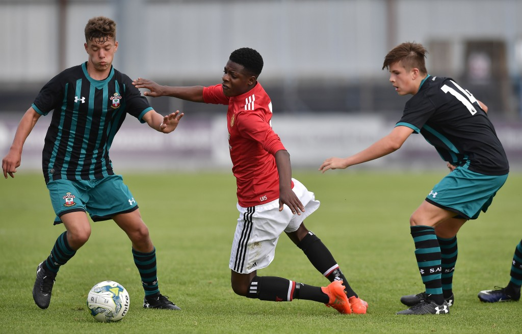 COLERAINE, NORTHERN IRELAND - JULY 26: Ademipo Odubeko (C) of Manchester United is fouled by Jack Turner (L) and Sam Bailey (R) of Southampton during the Super Cup NI tournament group game between Manchester United u16's and Southampton u16's at the Showgrounds on July 26, 2017 in Coleraine, Northern Ireland. (Photo by Charles McQuillan/Getty Images)