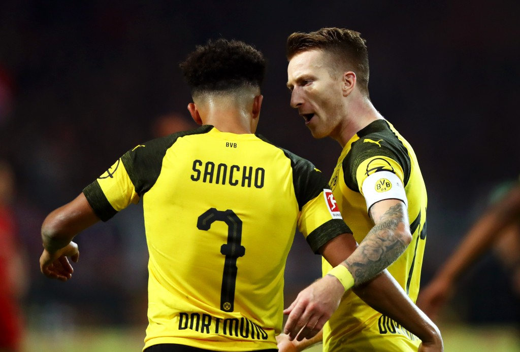 DORTMUND, GERMANY - NOVEMBER 10: Marco Reus of Borussia Dortmund celebrates with teammate Jadon Sancho after scoring his team's second goal during the Bundesliga match between Borussia Dortmund and FC Bayern Muenchen at Signal Iduna Park on November 10, 2018 in Dortmund, Germany. (Photo by Dean Mouhtaropoulos/Bongarts/Getty Images)