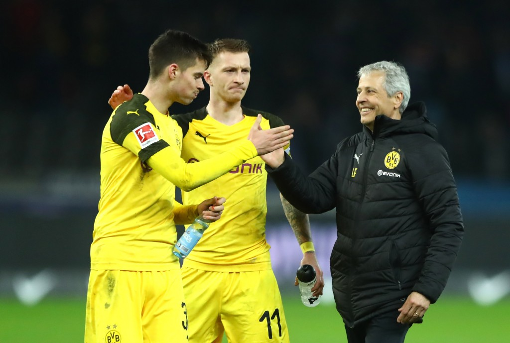 BERLIN, GERMANY - MARCH 16: (L-R) Julian Weigl, Marco Reus and Lucien Favre, Manager of Borussia Dortmund celebrate victory following the Bundesliga match between Hertha BSC and Borussia Dortmund at Olympiastadion on March 16, 2019 in Berlin, Germany. (Photo by Martin Rose/Bongarts/Getty Images)