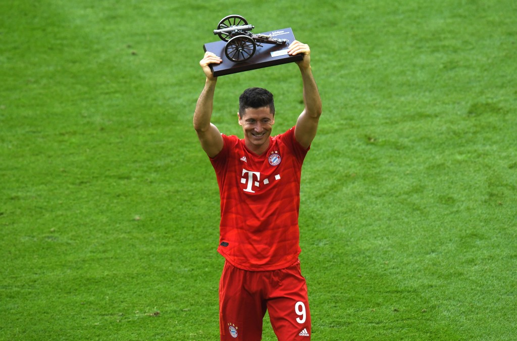Bayern Munich's Polish forward Robert Lewandowski celebrates with his trophy for top goal scorer of the German First division Bundesliga football match FC Bayern Munich v Eintracht Frankfurt in Munich, southern Germany, on May 18, 2019. (Photo by Christof STACHE / AFP) / DFL REGULATIONS PROHIBIT ANY USE OF PHOTOGRAPHS AS IMAGE SEQUENCES AND/OR QUASI-VIDEO (Photo credit should read CHRISTOF STACHE/AFP/Getty Images)