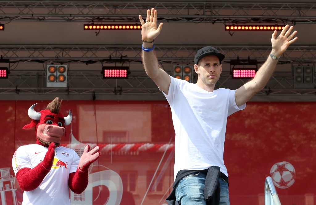 LEIPZIG, GERMANY - MAY 26: Peter Gulacsi of Leipzig celebrates with fans during the RB Leipzig Fanfest at Festwiese on May 26, 2019 in Leipzig, Germany. (Photo by Matthias Kern/Bongarts/Getty Images)