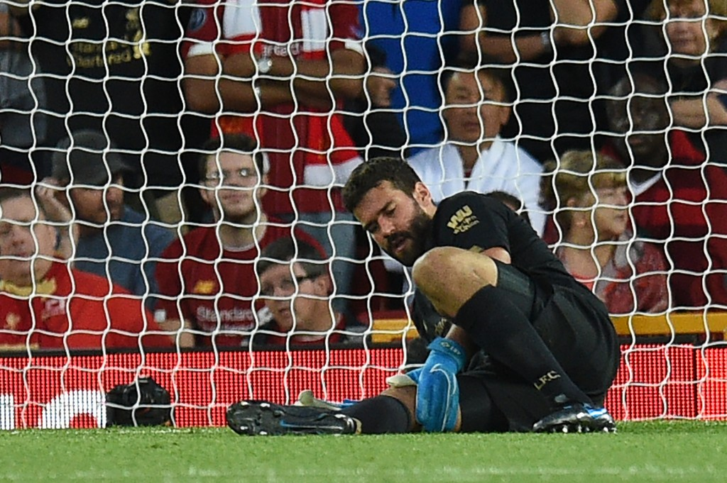 Liverpool fans will be sweating over Alisson's fitness. (Photo by Oli Scarff/AFP/Getty Images)