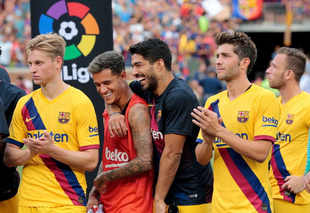 Coutinho (2nd from left) is not going anywhere. (Photo by Jeff Kowalsky/AFP/Getty Images)