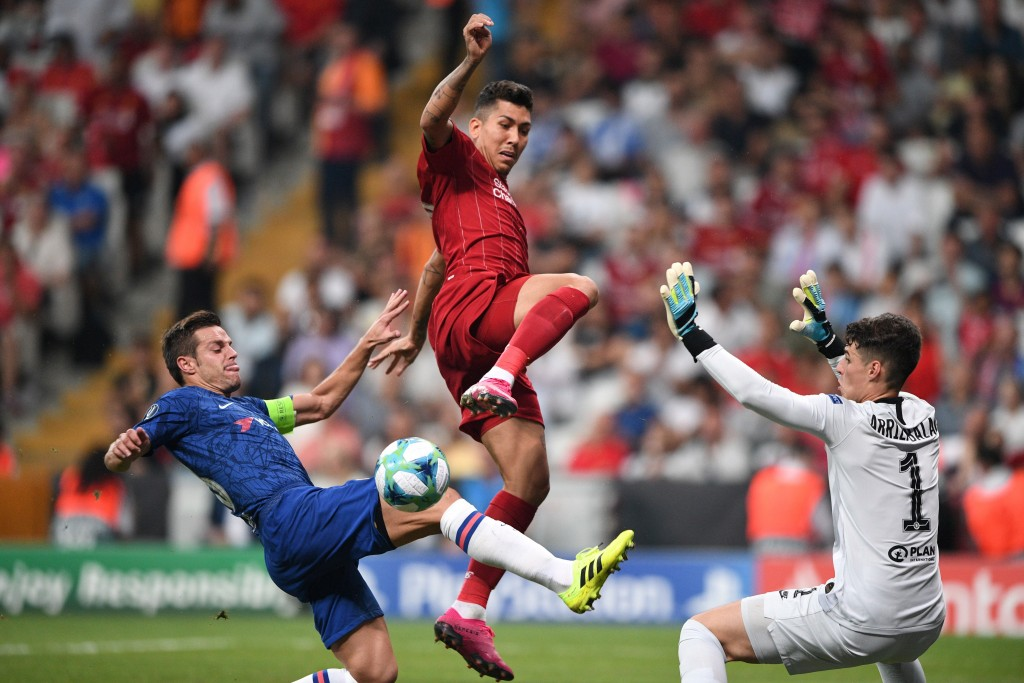 Kepa caught in two minds leading to Liverpool equalizer (Photo by BULENT KILIC/AFP/Getty Images)