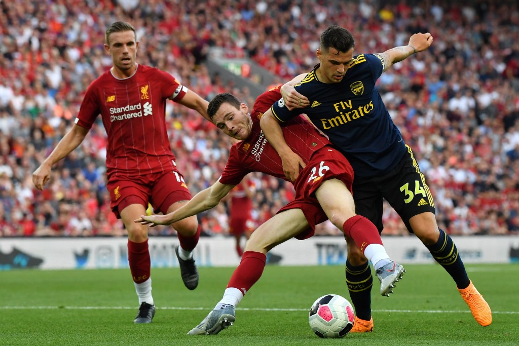 Outnumbered and outperformed was the story of Xhaka against Liverpool. (Photo by Ben Stansall/AFP/Getty Images)