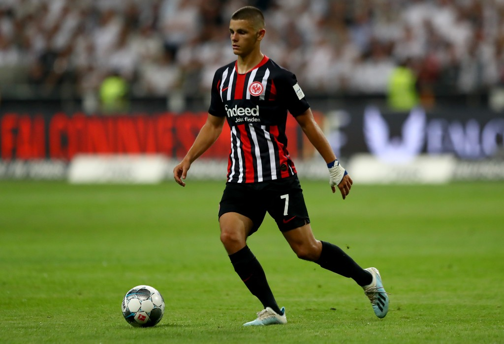 FRANKFURT AM MAIN, GERMANY - AUGUST 01: Dejan Joveljic of Frankfurt runs with the ball during the UEFA Europa League Second Qualifying Round 2nd Leg match between Eintracht Frankfurt and FC Flora Tallinn at Commerzbank-Arena on August 01, 2019 in Frankfurt am Main, Germany. (Photo by Martin Rose/Bongarts/Getty Images)