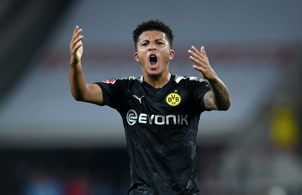 COLOGNE, GERMANY - AUGUST 23: Jadon Sancho of Borussia Dortmund celebrates scoring his side's first goal during the Bundesliga match between 1. FC Koeln and Borussia Dortmund at RheinEnergieStadion on August 23, 2019 in Cologne, Germany. (Photo by Matthias Hangst/Bongarts/Getty Images)