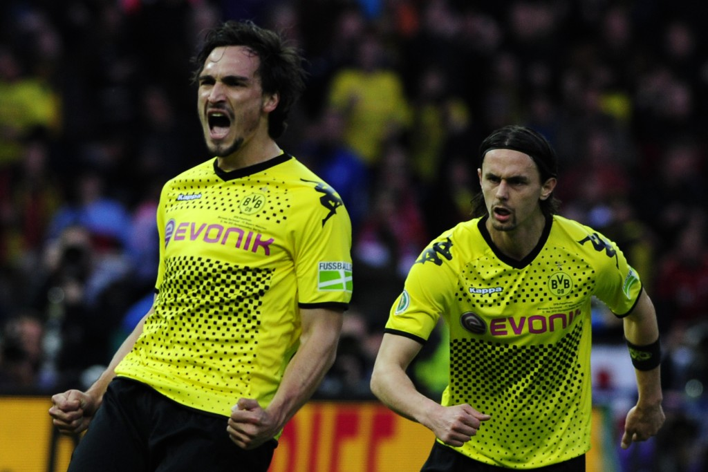 """Dortmund's defender Mats Hummels (L) celebrates with his teammate Dortmund's US defender Neven Subotic after scoring the 2-1 during the German cup """" DFB Pokal """" final football match Borussia Dortmund vs Bayern Munich at the Olympiastadion in Berlin on May 12, 2012. AFP PHOTO / JOHN MACDOUGALL RESTRICTIONS / EMBARGO - DFB LIMITS THE USE OF IMAGES ON THE INTERNET TO 15 PICTURES (NO VIDEO-LIKE SEQUENCES) DURING THE MATCH AND PROHIBITS MOBILE (MMS) USE DURING AND FOR FURTHER TWO HOURS AFTER THE MATCH. FOR MORE INFORMATION CONTACT DFB. (Photo credit should read JOHN MACDOUGALL/AFP/GettyImages)"""
