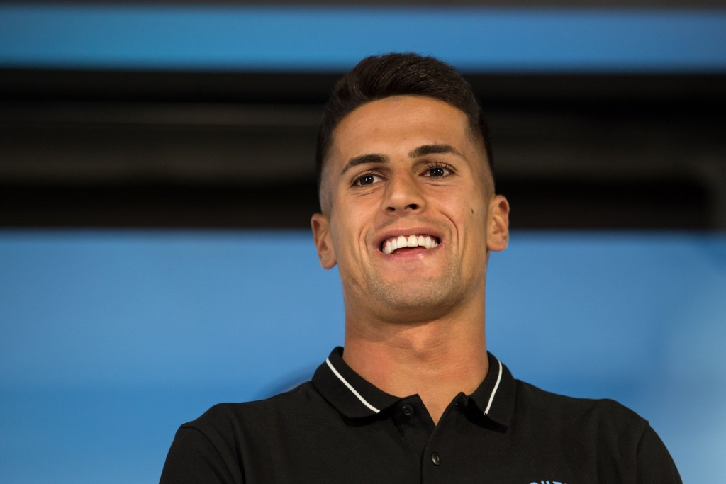 A big day for Cancelo. (Photo by Oli Scarff/AFP/Getty Images)