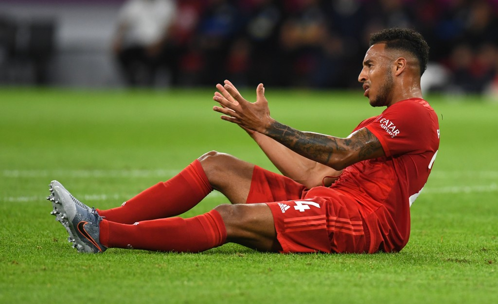 Bayern Munich's French midfielder Corentin Tolisso ends up on the grass after a foul during the German First division Bundesliga football match FC Bayern Munich v Hertha Berlin in Munich, southern Germany, on August 16, 2019. (Photo by Christof STACHE / AFP) / DFL REGULATIONS PROHIBIT ANY USE OF PHOTOGRAPHS AS IMAGE SEQUENCES AND/OR QUASI-VIDEO (Photo credit should read CHRISTOF STACHE/AFP/Getty Images)