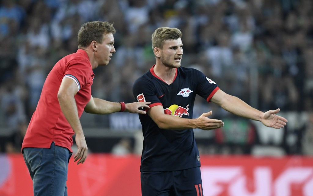 Leipzig's German headcoach Julian Nagelsmann and Leipzig's German forward Timo Werner (R) talk during the German first division Bundesliga football match Borussia Moenchengladbach v RB Leipzig in Moenchengladbach, western Germany on August 30, 2019. (Photo by Ina FASSBENDER / AFP) / RESTRICTIONS: DFL REGULATIONS PROHIBIT ANY USE OF PHOTOGRAPHS AS IMAGE SEQUENCES AND/OR QUASI-VIDEO (Photo credit should read INA FASSBENDER/AFP/Getty Images)