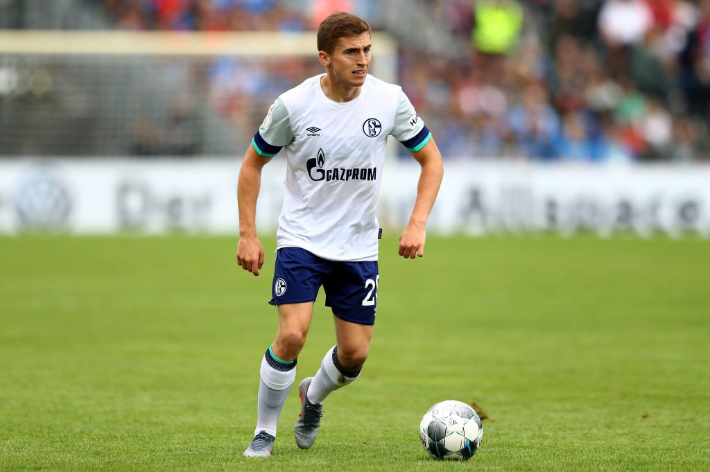DROCHTERSEN, GERMANY - AUGUST 10: Jonjoe Kenny of Schalke runs with the ball during the DFB Cup first round match between SV Drochtersen Assel and FC Schalke 04 at Kehdinger Stadion on August 10, 2019 in Drochtersen, Germany. (Photo by Martin Rose/Bongarts/Getty Images)
