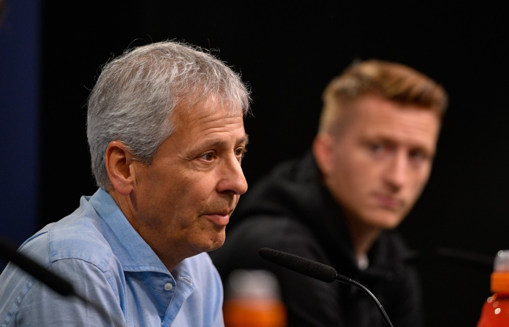 Dortmund's Swiss coach Lucien Favre and Dortmund's German forward Marco Reus are pictured during a press conference in Dortmund, western Germany, on September 16, 2019 on the eve of the UEFA Champions League Group F football match between Borussia Dortmund and Barcelona. (Photo by SASCHA SCHUERMANN / AFP) (Photo credit should read SASCHA SCHUERMANN/AFP/Getty Images)