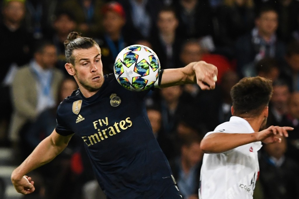 Bale had a goal ruled out for handball (Photo by MARTIN BUREAU/AFP/Getty Images)