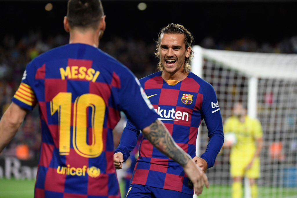 Messi and Griezmann combined for Barcelona's opener (Photo by LLUIS GENE/AFP/Getty Images)
