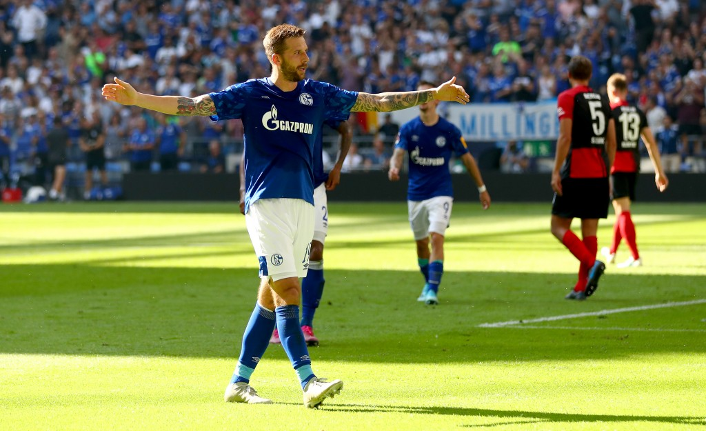 GELSENKIRCHEN, GERMANY - AUGUST 31: Guido Burgstaller of Schalke and Daniel Caligiuri of Schalke celebrate after the first goal during the Bundesliga match between FC Schalke 04 and Hertha BSC at Veltins-Arena on August 31, 2019 in Gelsenkirchen, Germany. (Photo by Lars Baron/Bongarts/Getty Images)