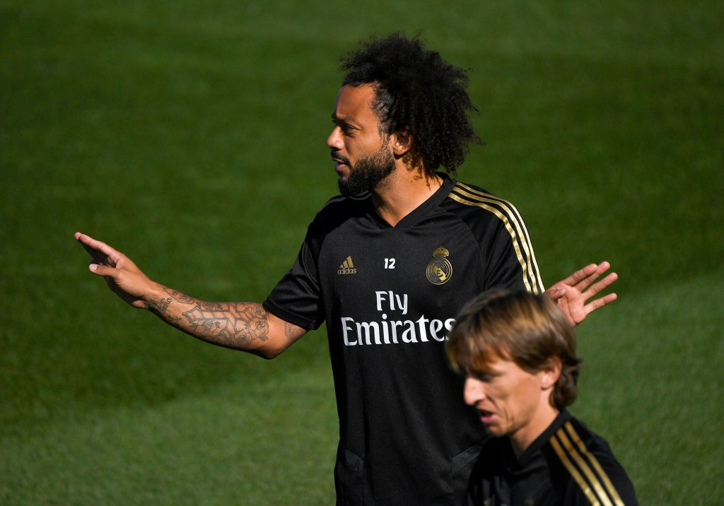 Marcelo and Modric are back in training (Photo by PIERRE-PHILIPPE MARCOU/AFP/Getty Images)