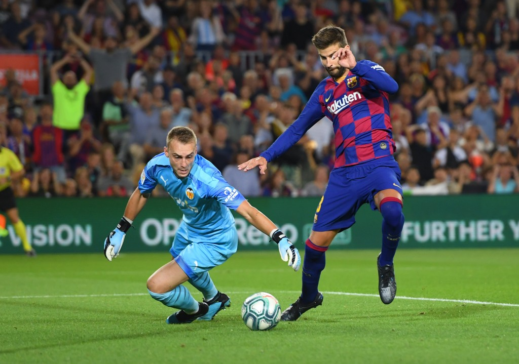 Pique scored Barcelona's third goal (Photo by Alex Caparros/Getty Images)
