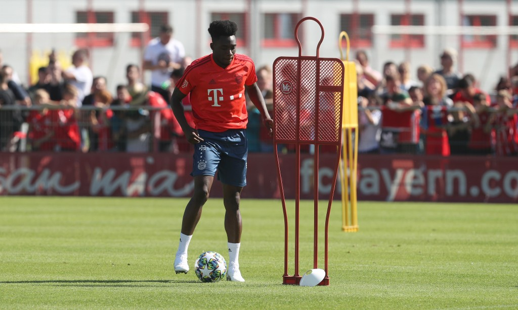 MUNICH, GERMANY - SEPTEMBER 15: Alphonso Davies of FC Bayern Muenchen kicks the ball during a training session at Saebener Strasse training ground on September 15, 2019 in Munich, Germany. (Photo by Alexandra Beier/Bongarts/Getty Images)