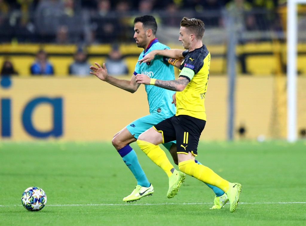 Busquets found it difficult tp cope with Dortmund's pace (Photo by Martin Rose/Bongarts/Getty Images)