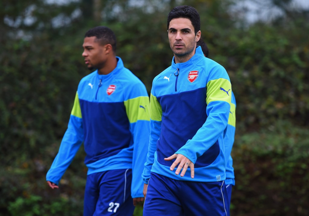ST ALBANS, ENGLAND - NOVEMBER 03: (L-R) Serge Gnabry and Mikel Arteta look on during an Arsenal training session ahead of the UEFA Champions League match against RSC Anderlecht at London Colney on November 3, 2014 in St Albans, England. (Photo by Michael Regan/Getty Images)