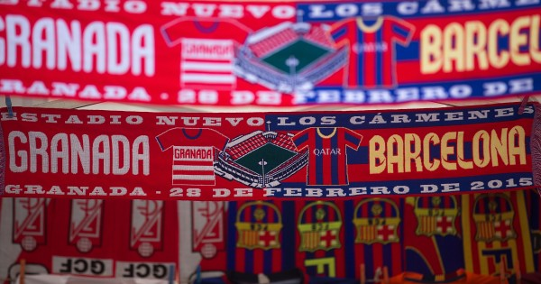 GRANADA, SPAIN - FEBRUARY 28: The Match,s scarf  is displayed at a merchandaising stall outside Nuevo Estadio de los Carmenes before the La Liga match between Granada CF and FC Barcelona on February 28, 2015 in Granada, Spain.  (Photo by Gonzalo Arroyo Moreno/Getty Images)