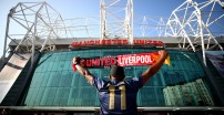 MANCHESTER, ENGLAND - FEBRUARY 24:  A fan holds up a scarf ourisde the stadium ahead of the Premier League match between Manchester United and Liverpool FC at Old Trafford on February 24, 2019 in Manchester, United Kingdom.  (Photo by Clive Brunskill/Getty Images)