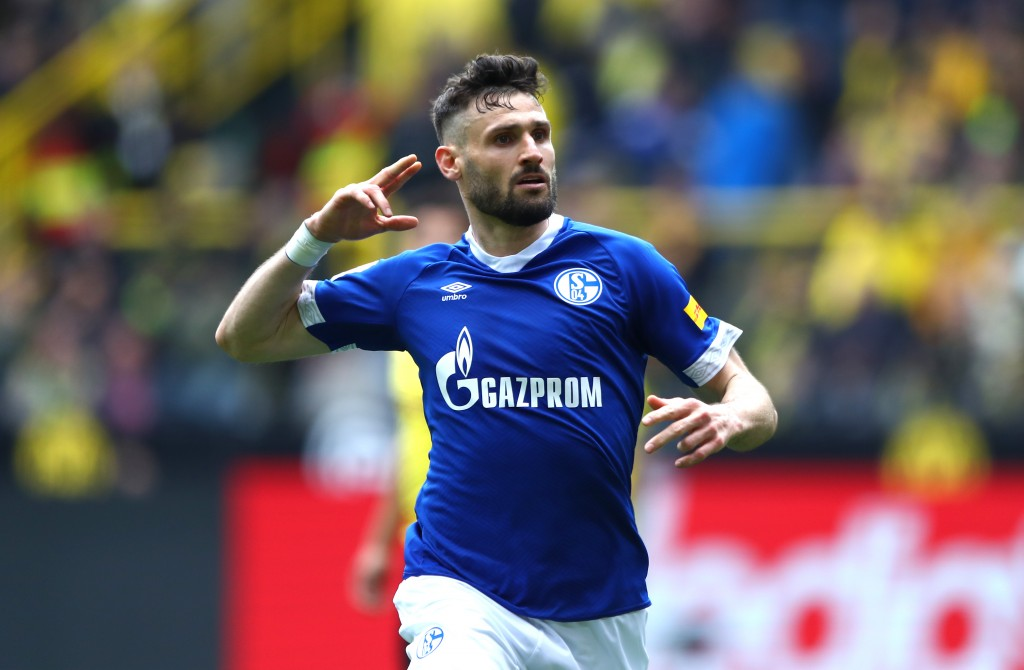 DORTMUND, GERMANY - APRIL 27: Daniel Caligiuri of FC Schalke 04 celebrates after scoring his team's third goal during the Bundesliga match between Borussia Dortmund and FC Schalke 04 at Signal Iduna Park on April 27, 2019 in Dortmund, Germany. (Photo by Martin Rose/Bongarts/Getty Images)