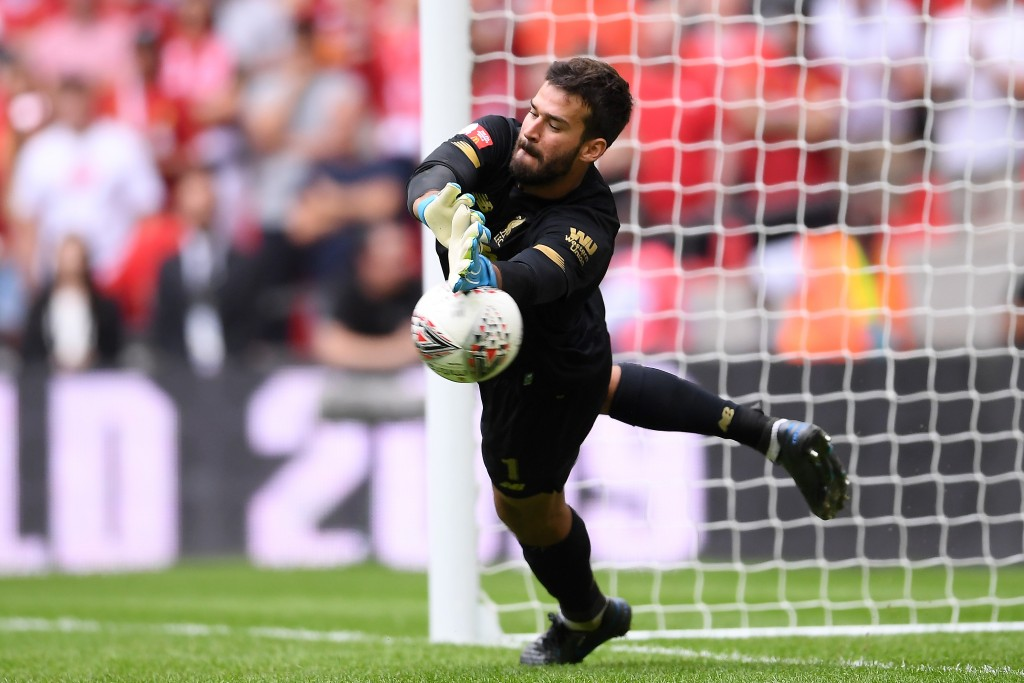 Could Alisson be back in action against Leicester City? (Photo by Laurence Griffiths/Getty Images)