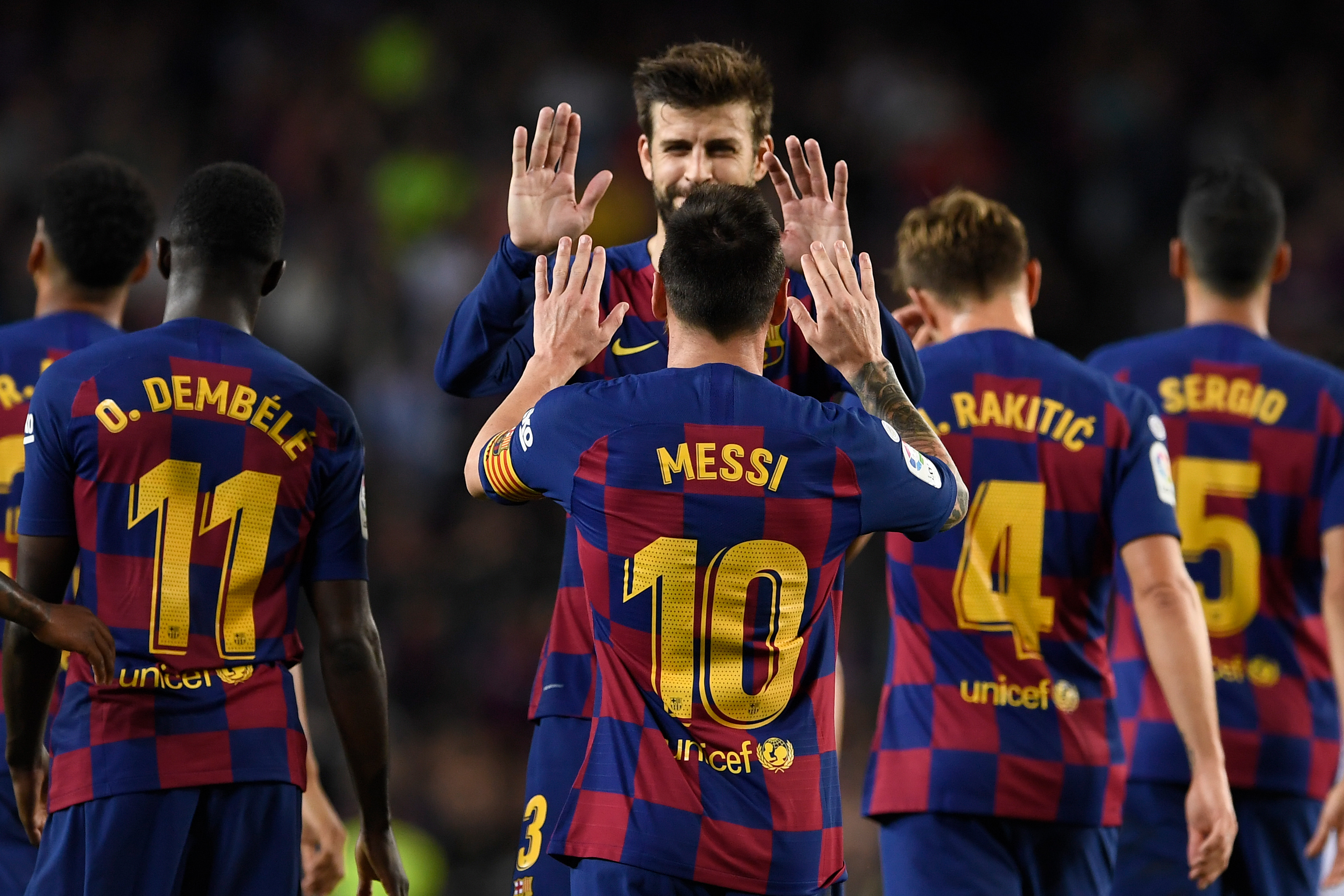 TOPSHOT - Barcelona's Argentine forward Lionel Messi celebrates his goal with Barcelona's Spanish defender Gerard Pique during the Spanish league football match between FC Barcelona and Sevilla FC at the Camp Nou stadium in Barcelona on October 6, 2019. (Photo by Josep LAGO / AFP) (Photo by JOSEP LAGO/AFP via Getty Images)
