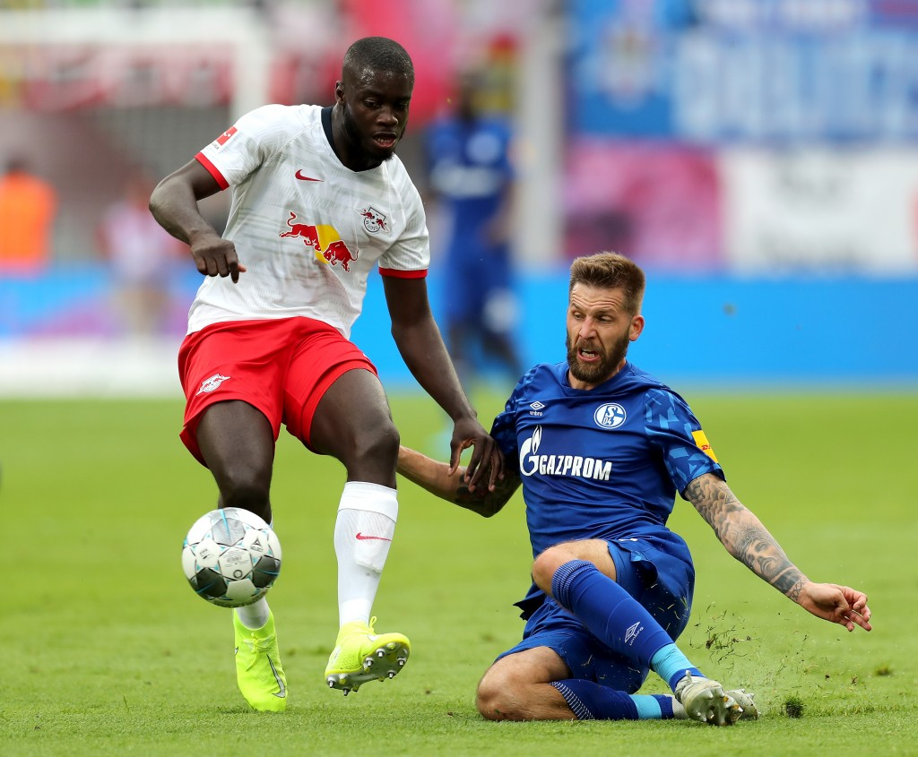 Upamecano (L) remains on Arsenal's radar. (Photo by Boris Streubel/Bongarts/Getty Images)