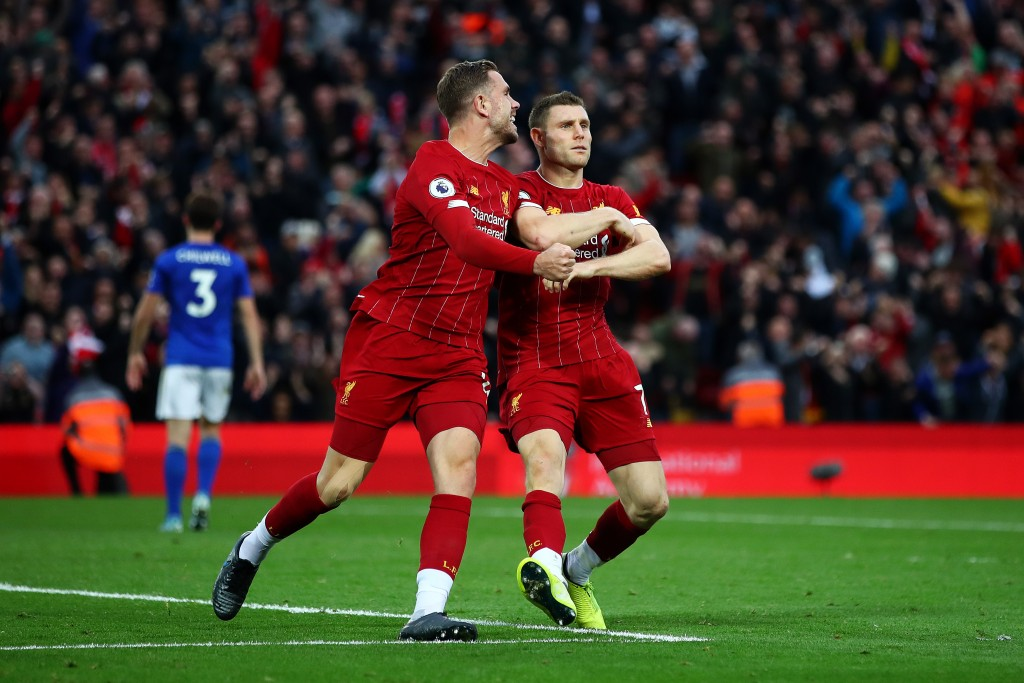 LIVERPOOL, ENGLAND - OCTOBER 05: James Milner of Liverpool celebrates with Jordan Henderson of Liverpool and Divock Origi of Liverpool after he scores his sides second goal from the penalty spot during the Premier League match between Liverpool FC and Leicester City at Anfield on October 05, 2019 in Liverpool, United Kingdom. (Photo by Clive Brunskill/Getty Images)