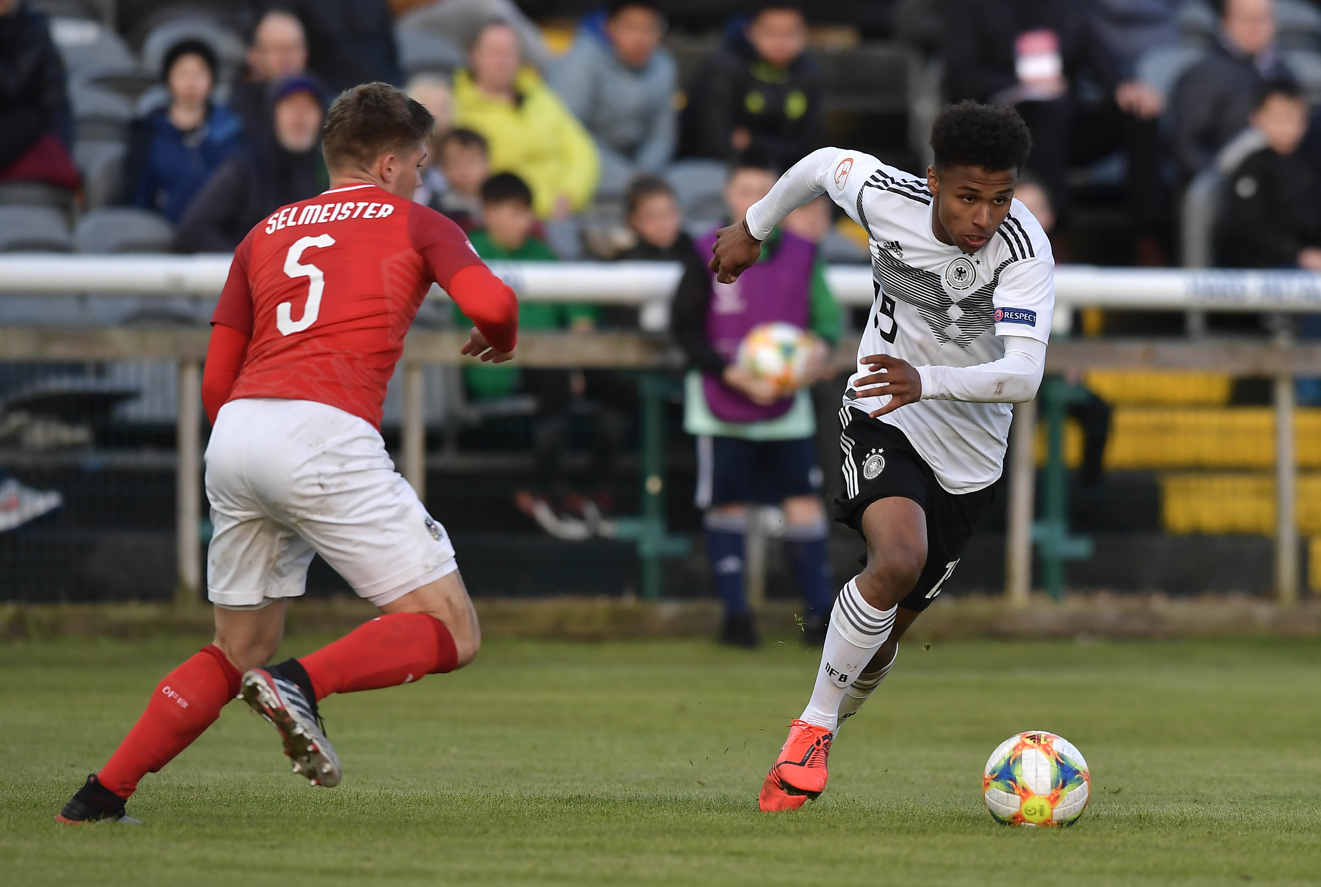 DUBLIN, IRELAND - MAY 10: Karim Adeyemi of Germany and Julian Selmeister of Austria during the UEFA Under 17 European Championship Group D football match between Austria and Germany at Carlisle Grounds stadium on May 10, 2019 in Dublin, Ireland. (Photo by Charles McQuillan/Getty Images)