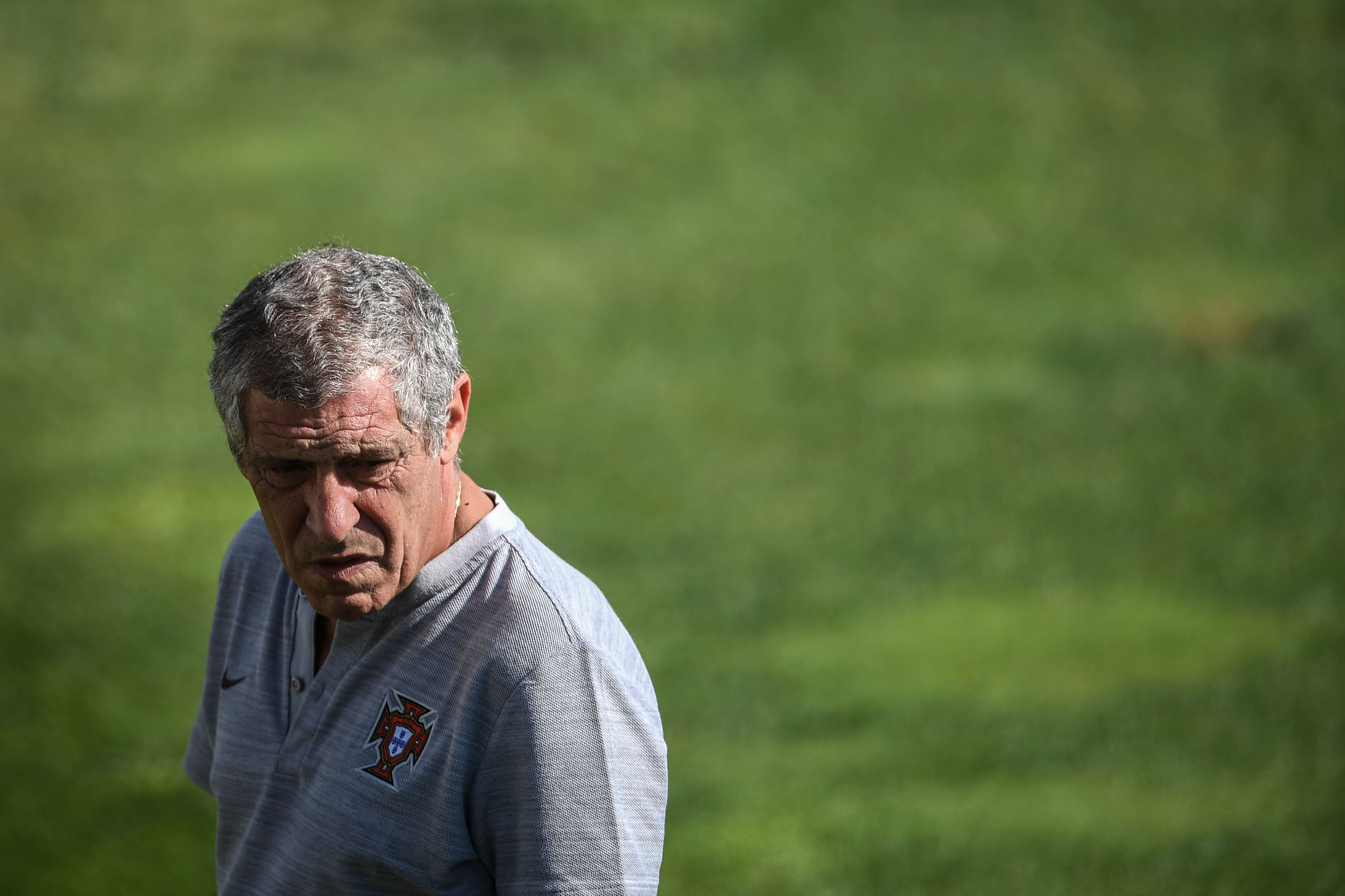 """Portugal's head coach Fernando Santos looks on during a training session at """"Cidade do Futebol"""" training camp in Oeiras, outskirts of Lisbon on September 3, 2019, ahead of the Euro 2020 football qualification match between Portugal and Serbia. (Photo by PATRICIA DE MELO MOREIRA / AFP) (Photo credit should read PATRICIA DE MELO MOREIRA/AFP via Getty Images)"""