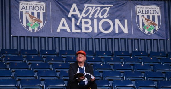 WEST BROMWICH, ENGLAND - AUGUST 21:  A West Bromwich Albion fan reads a programme in the stands before the Sky Bet Championship match between West Bromwich Albion and Reading at The Hawthorns on August 21, 2019 in West Bromwich, England. (Photo by Laurence Griffiths/Getty Images)