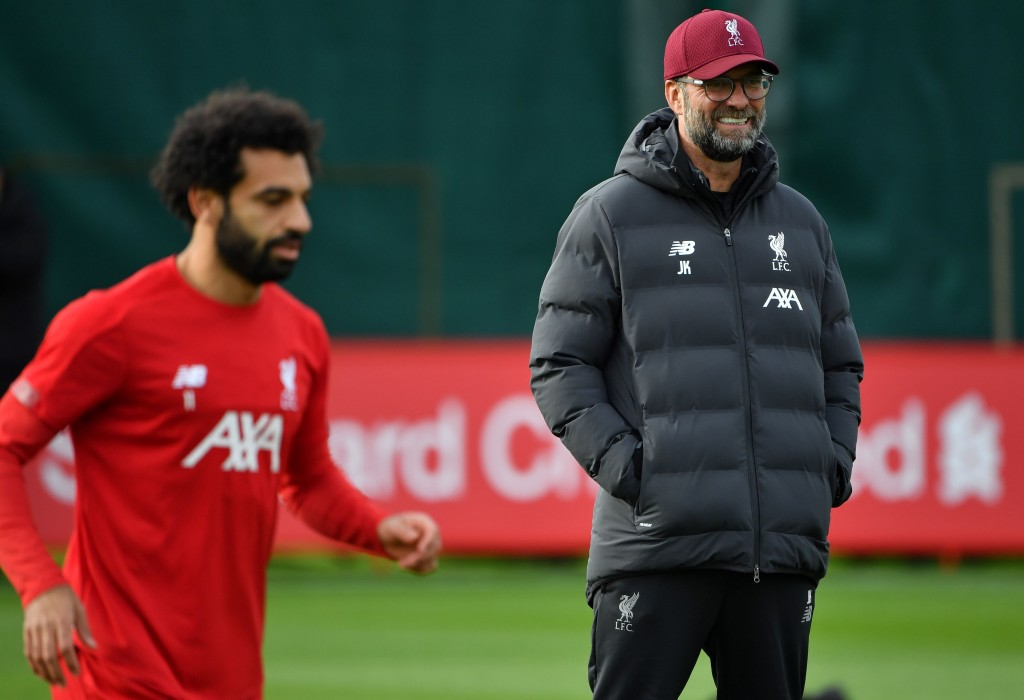 Liverpool's Egyptian midfielder Mohamed Salah (L) and Liverpool's German manager Jurgen Klopp attend a team training session at Melwood in Liverpool, north west England on October 22, 2019, on the eve of their UEFA Champions League Group E football match against Genk. (Photo by Paul ELLIS / AFP) (Photo by PAUL ELLIS/AFP via Getty Images)