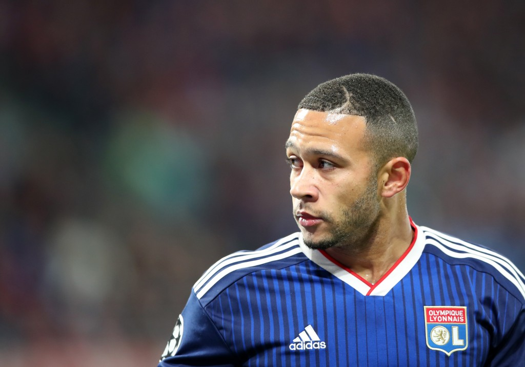 LEIPZIG, GERMANY - OCTOBER 02: Memphis Depay of Olympique Lyon during the UEFA Champions League group G match between RB Leipzig and Olympique Lyon at Red Bull Arena on October 02, 2019 in Leipzig, Germany. (Photo by Christian Kaspar-Bartke/Bongarts/Getty Images)