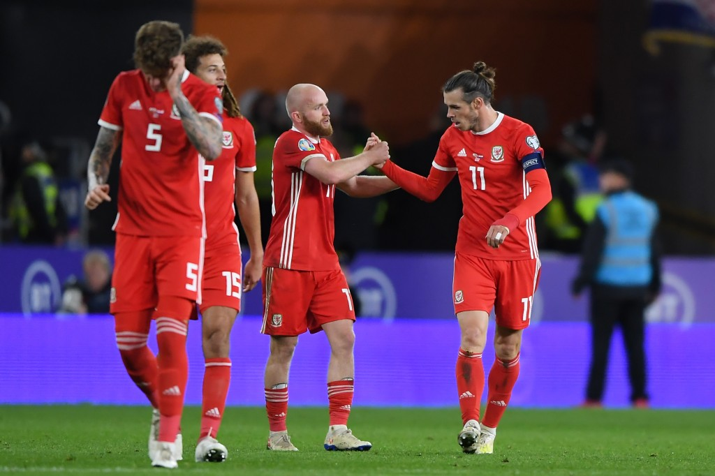 CARDIFF, WALES - OCTOBER 13: Gareth Bale of Wales celebrates scoring his sides first goal with Jonny Williams during the UEFA Euro 2020 qualifier between Wales and Croatia at Cardiff City Stadium on October 13, 2019 in Cardiff, Wales. (Photo by Alex Davidson/Getty Images)